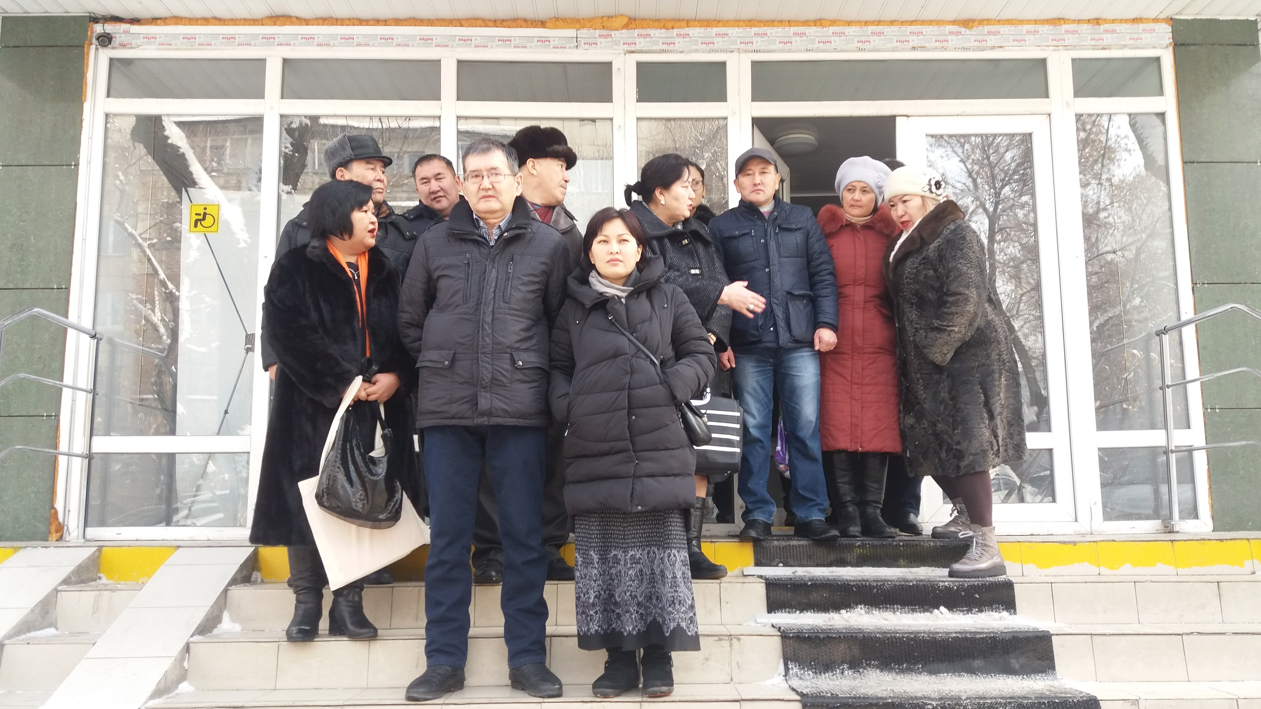 Supporters of Almat Zhumagulov and Kenzhebek Abishev outside an Almaty court