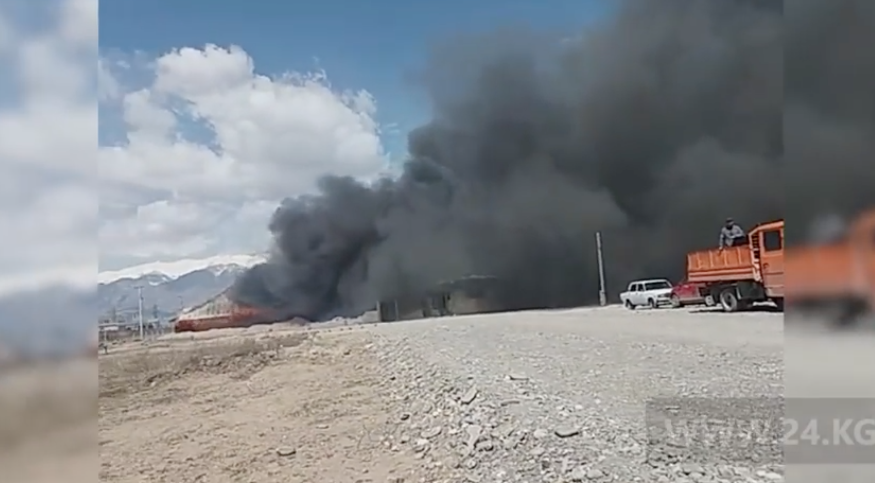 Screengrab of amateur footage showing the burning building in Kazarman.