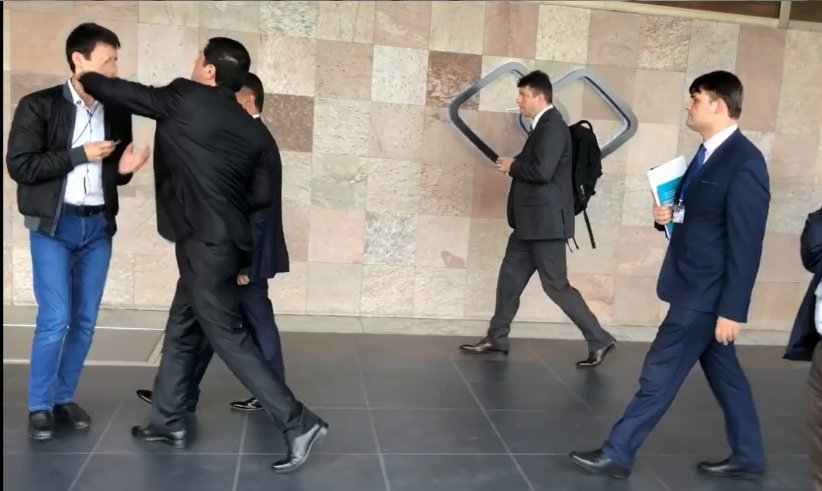 Screengrab showing moment when a Tajik official attacked an exiled opposition activist. (Photo: Mahmudjon Faizrahmon Twitter account)
