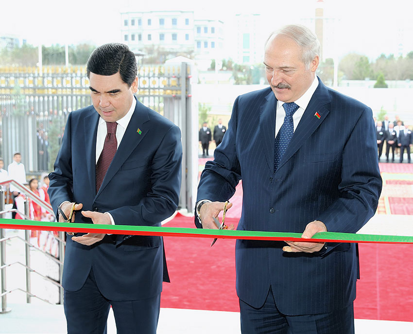 Cutting ties: Berdymukhamedov and Belarusian President Alexander Lukashenko at a ribbon-cutting ceremony at the new Belarusian Embassy in Ashgabat in March 2017. (Photo: Turkmenistan state news agency)