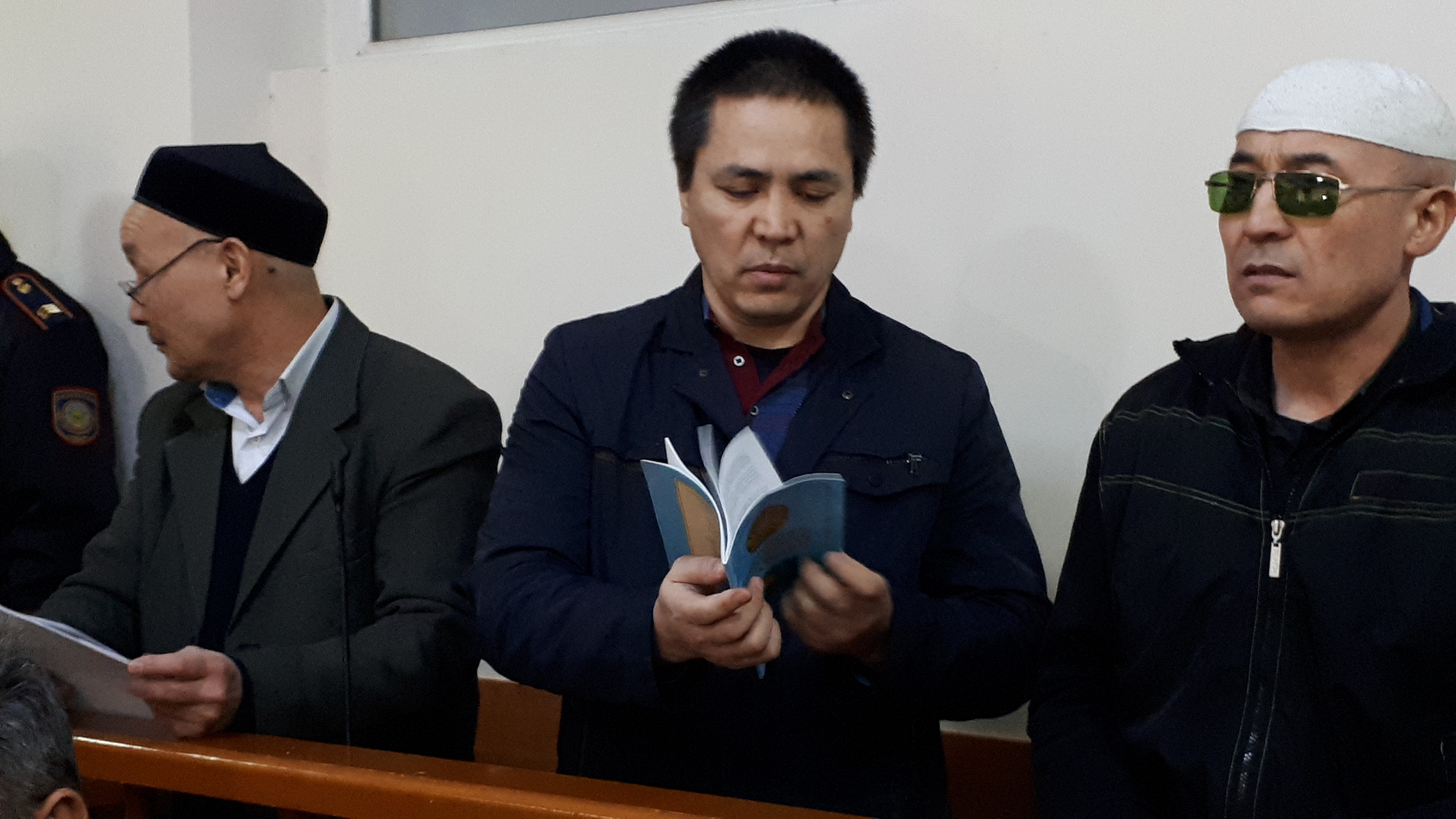 Left to right: Abishev, Zhumagulov and Omyrov at the Almaty court. (Photo: Joanna Lillis)