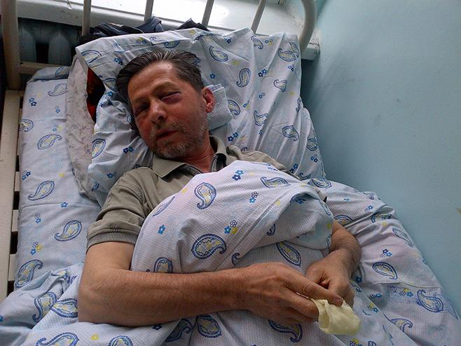 Mahmadali Hayit, seen lying in a hospital bed in a 2013 photo taken after he was assaulted outside his home by unknown attackers. (Photo: Human Rights Watch)