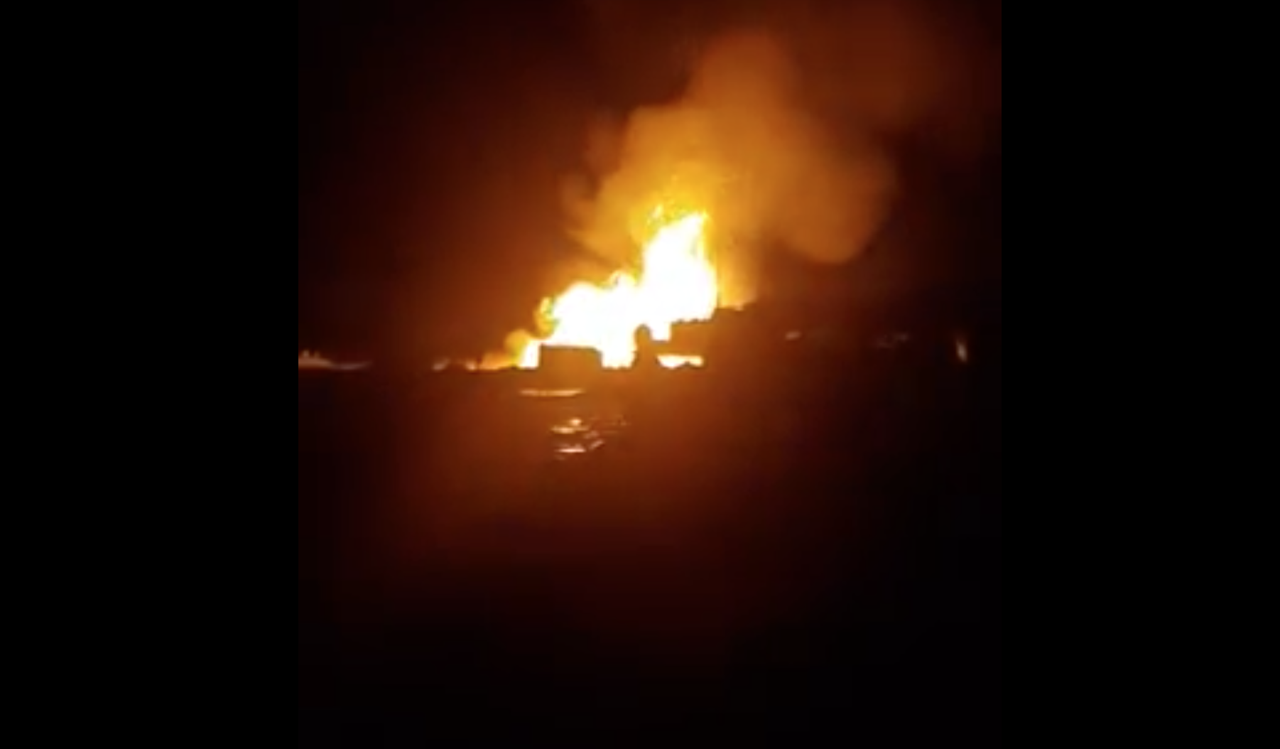 Nighttime footage of the fire captured on a phone camera. (Photo: Screengrab of video posted on Lada.kz website)