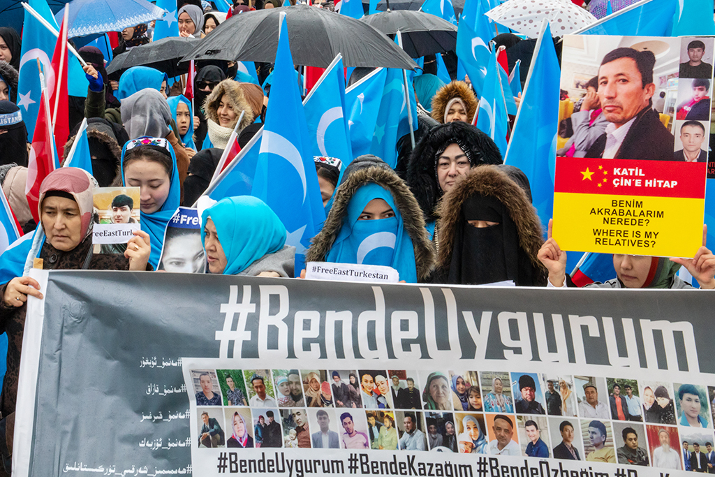 "Women hold a sign saying ""#MeTooUighur"" at a protest against China's indoctrination camps in Beyazıt Square last month."