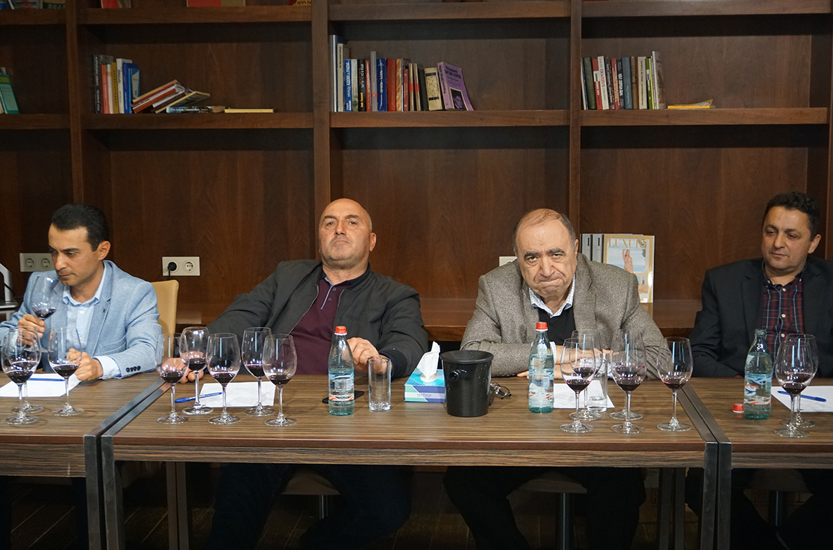 Karabakh winemakers sit for a blind tasting in Stepanakert. (all photos by David Kitai)