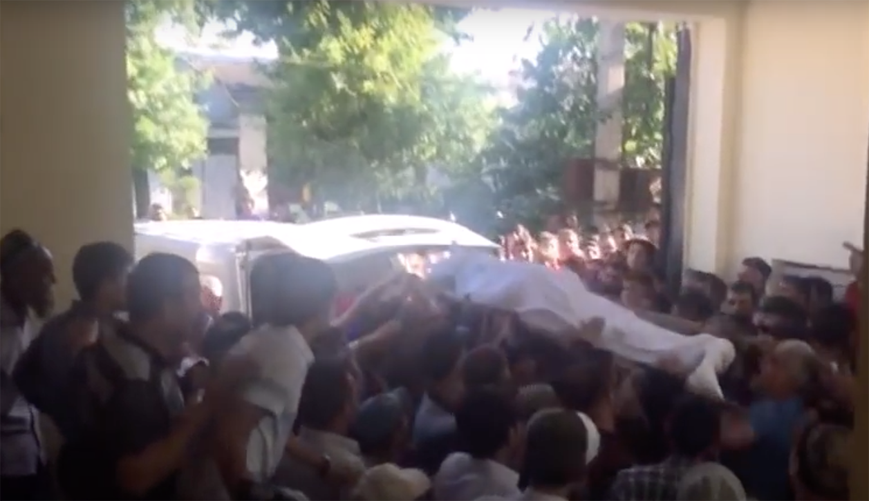 The body of Abduusattor Karimov being brought to his home, as seen in footage provided to Prague-based news website Akhbor. (Photo: Akhbor)