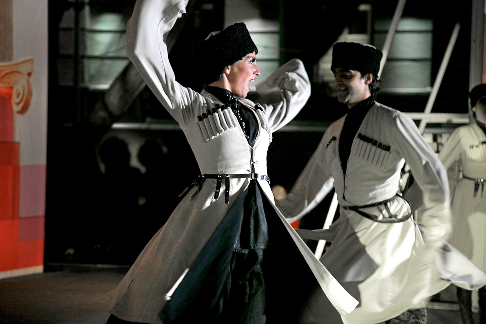 Woman wearing white chokhas perform traditional Georgian dance during a show of the Sukhishvili-Georgian National Ballet.