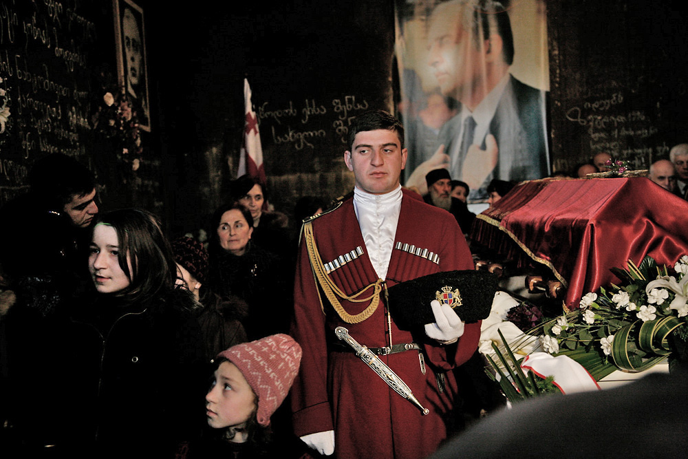 A presidential guard wears a traditional chokha during the public wake of Zviad Gamsakhurdia in the Kolkhuri Tower.