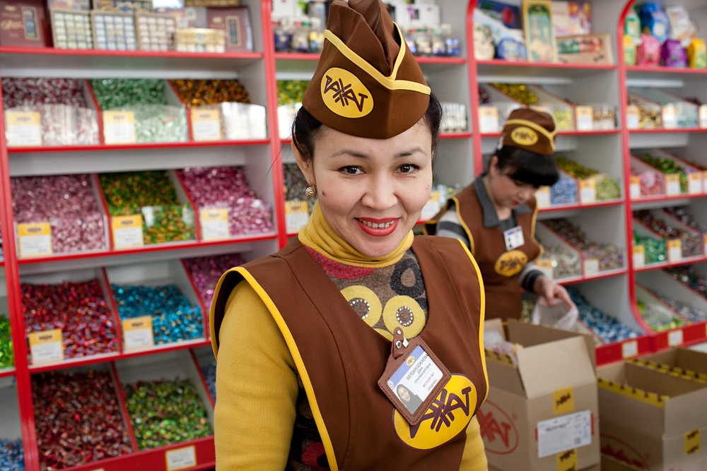 A sales lady at the Rakhat store helps shoppers select from dozens of candy variations.