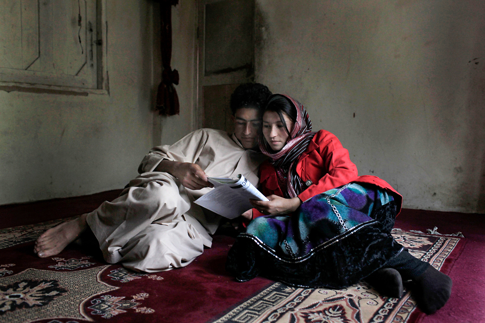 An Afghan couple, who met as students at Kabul's Central University, studies together in the town of Ishkashim, Afghanistan.