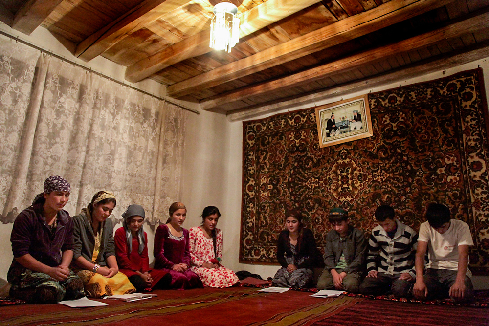 Tajik youth gather at a small mosque in Ishkashim for midnight prayer during the holy month of Ramadan.