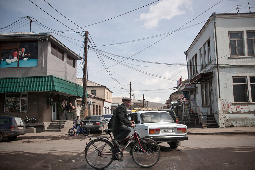 A cyclist rides through downtown Akhalkalaki, where Armenians comprise about 95 percent of the population.