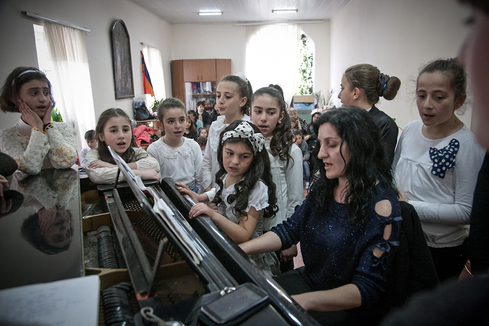 Armenian children sing at the Center of Armenian Culture run by the Armenian Church in the city of Akhalkalaki.