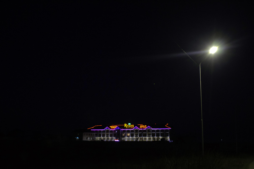 The Riviera casino sits alone in the pitch black on the shore of the Kapshagay reservoir.
