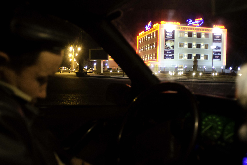 A taxi driver waits for a fare outside one of the 11 existing casinos.
