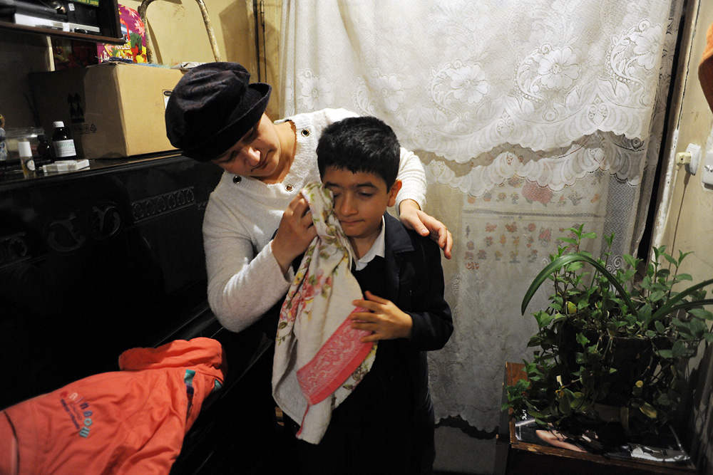 Gulnar Rzayeva and her son, Suleyman Rza, live in one of the last freestanding and undemolished homes on their block.