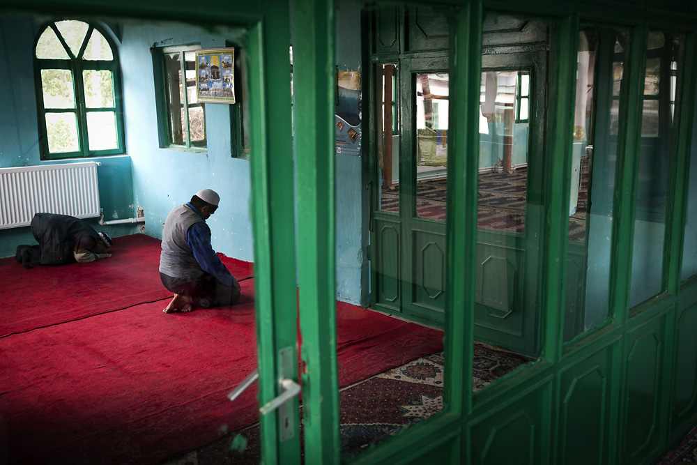 Kyrgyz elders pray at the local mosque in Ulupamir.