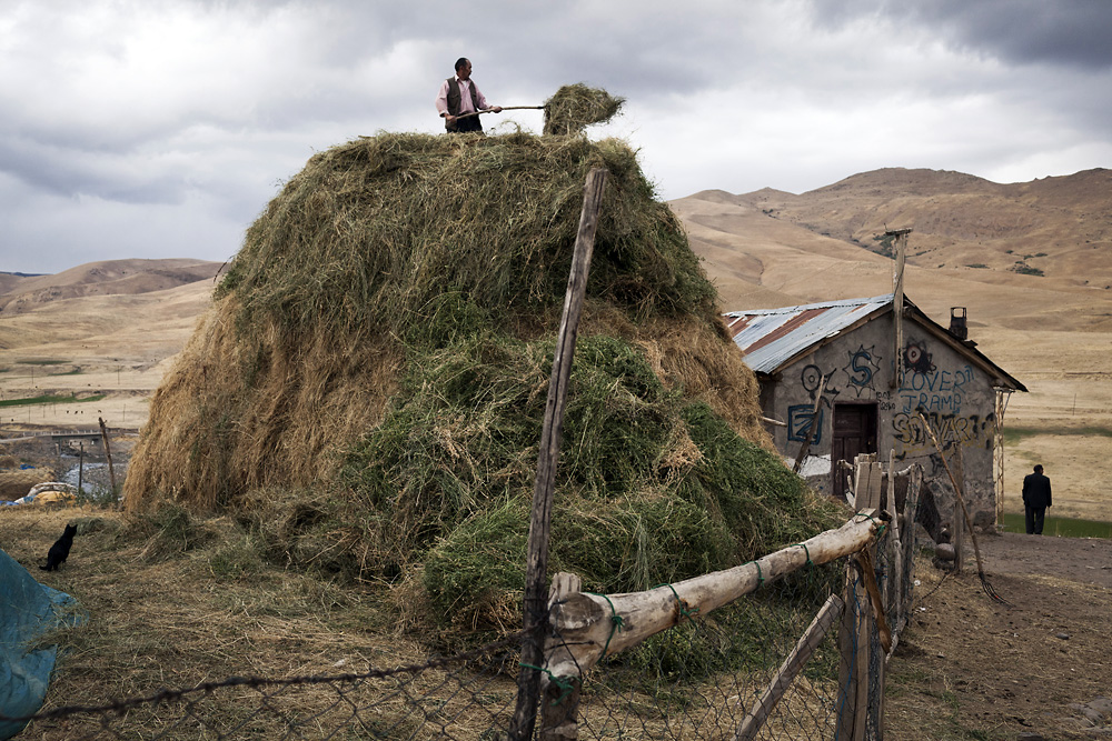 A Kyrgyz man manages his hay before the winter - an exercise previously impossible in the arid, high-altitude Wakhan corridor.