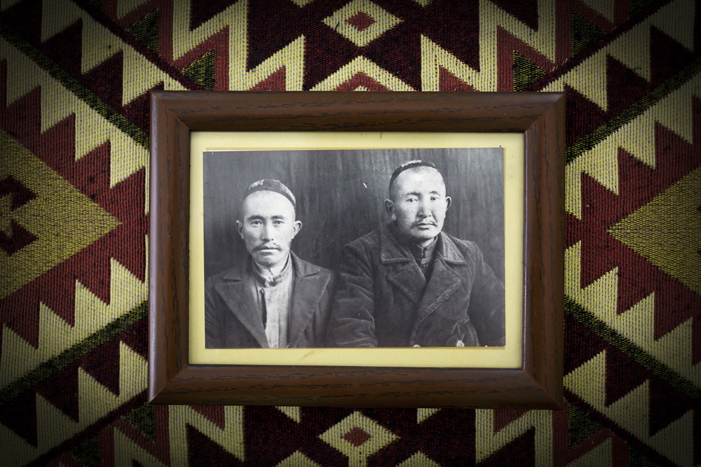 A portrait of Haji Rahman Kul (right) and a relative hangs in the home of his descendants in Istanbul.