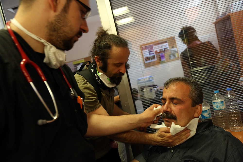 A leader of the protest movement is treated for tear gas exposure.