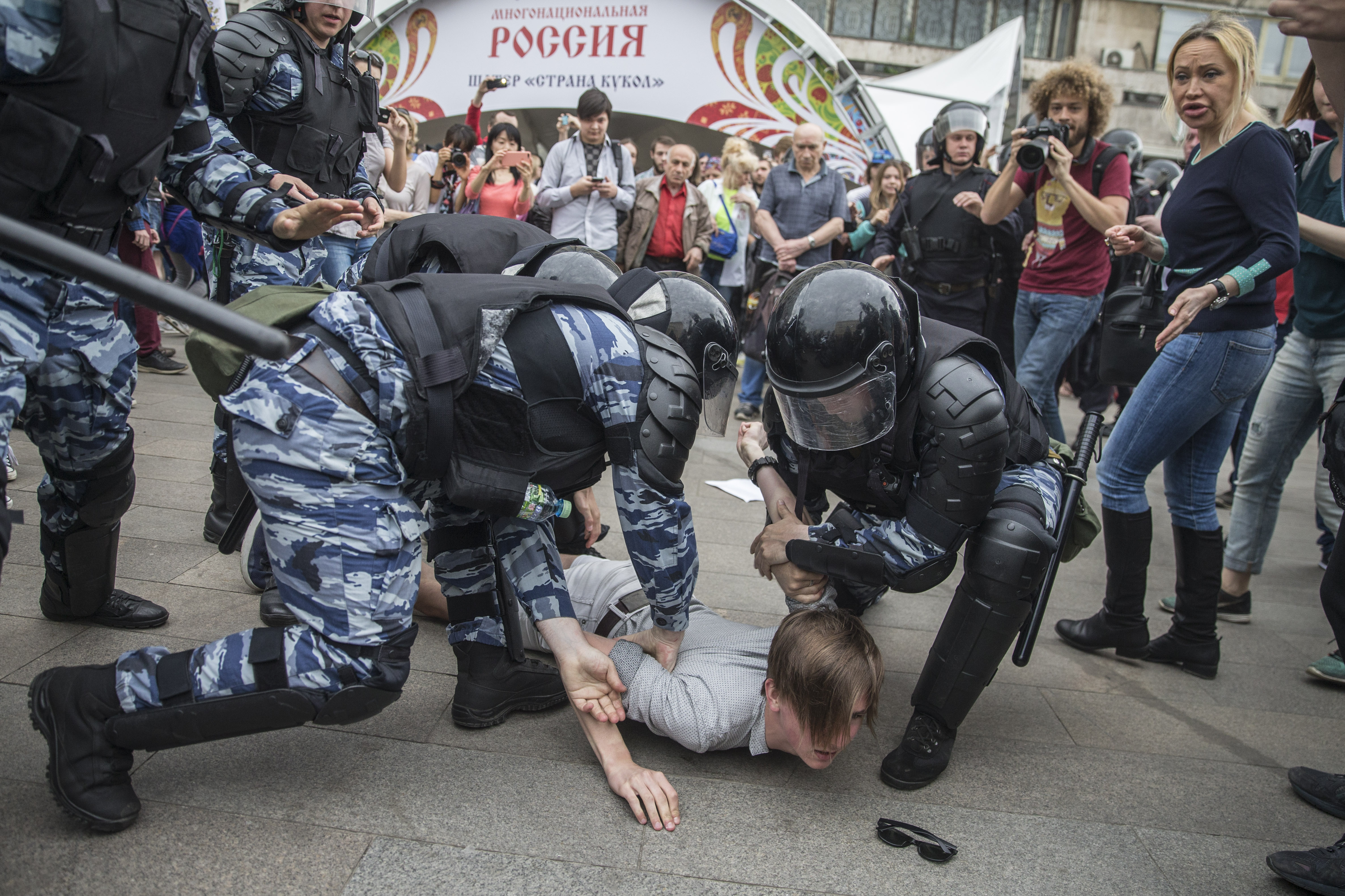 Riot police hold down a protester during a rally in Moscow on June 12. (Photo: Evgeny Feldman/This Is Navalny project)