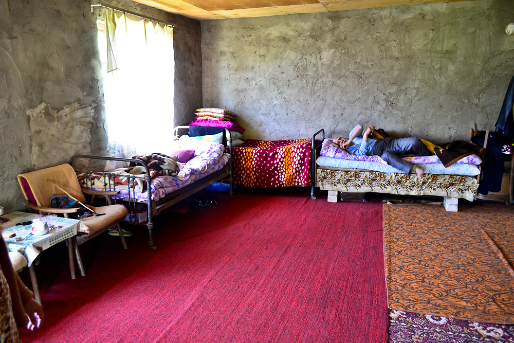 Rebiyen Melikov and her father, along with several children, occupy a single room that survived the flooding.