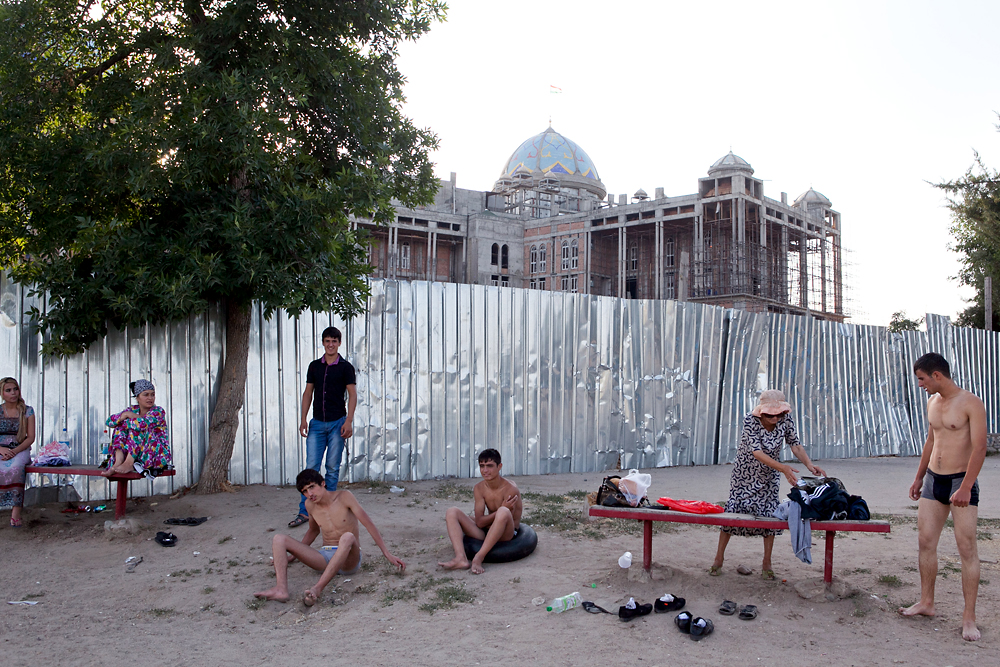 Behind bathers at Komsomol Lake, the shell of the teahouse undergoes construction in summer 2012. (Photo: David Trilling)