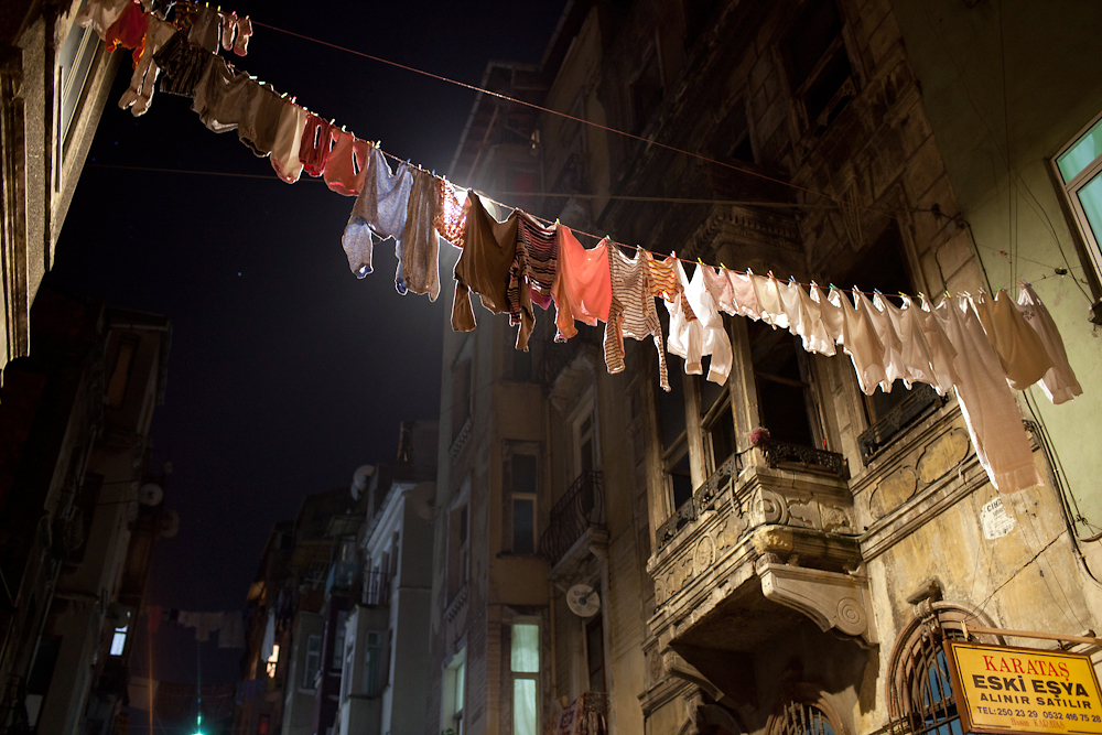Freshly washed clothes stretch between apartments across the formerly grand road in the Istanbul neighborhood of Tarlabasi.