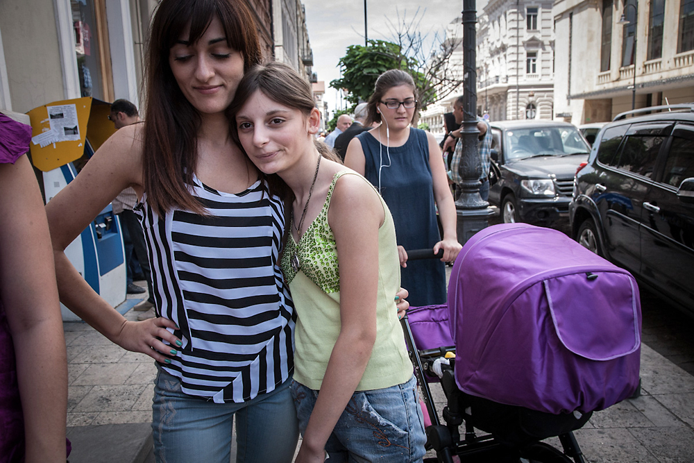 Jvelauri hugs 13-year-old Anna, who has not attended school for the