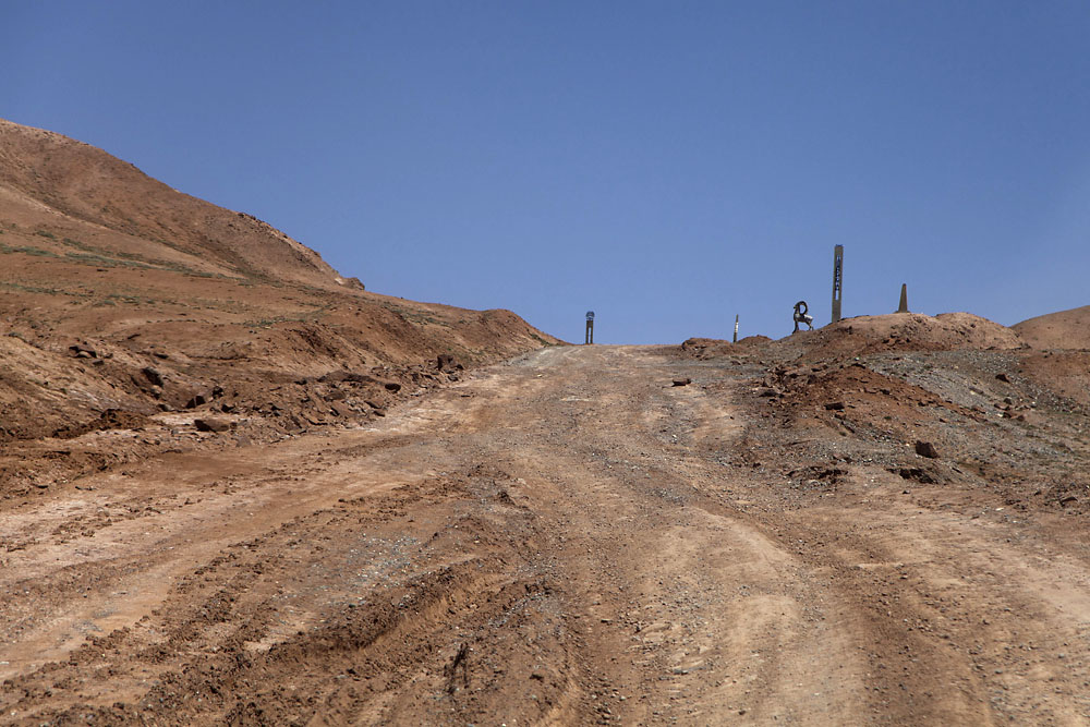 The approach to the Kyzyl-Art Pass is a rutted dirt road.