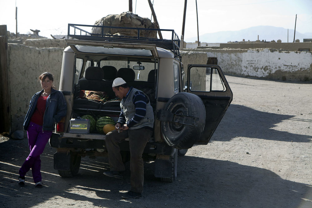 Along the way Khalli, an ethnic Kyrgyz driver, sells fruit and vegetables in Tajikistan that he bought in Osh.