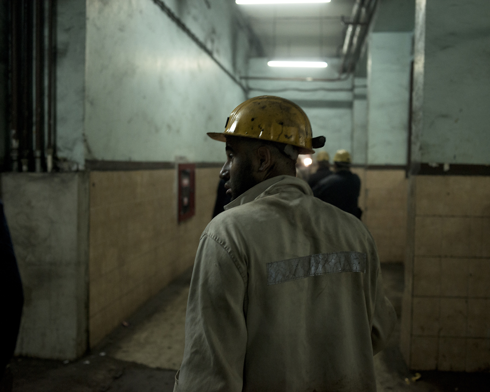 A coal miner heads for the showers after an 8-hour shift nearly 2,000 feet under ground.