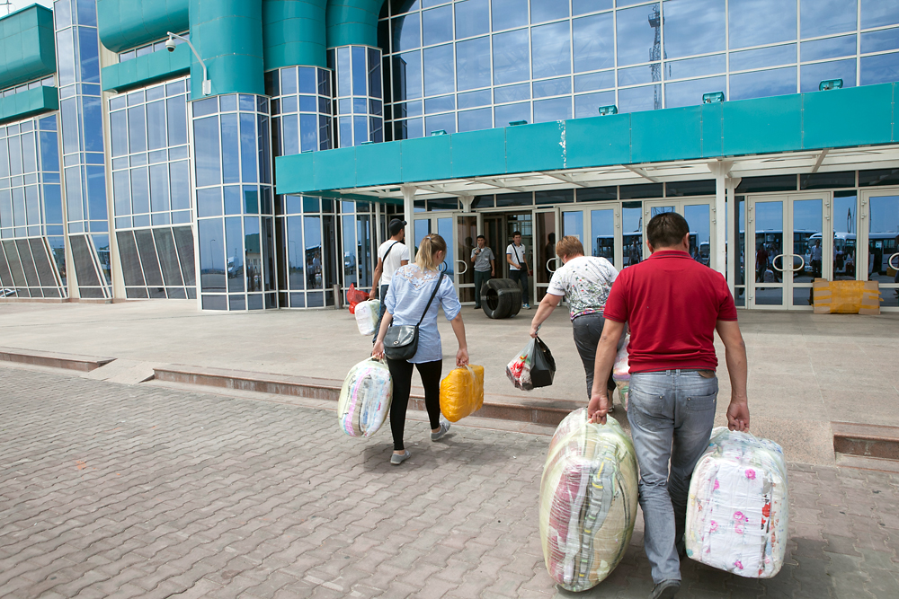 Returning to Kazakhstan with their purchases, Kazakhstanis enter a large new customs facility.