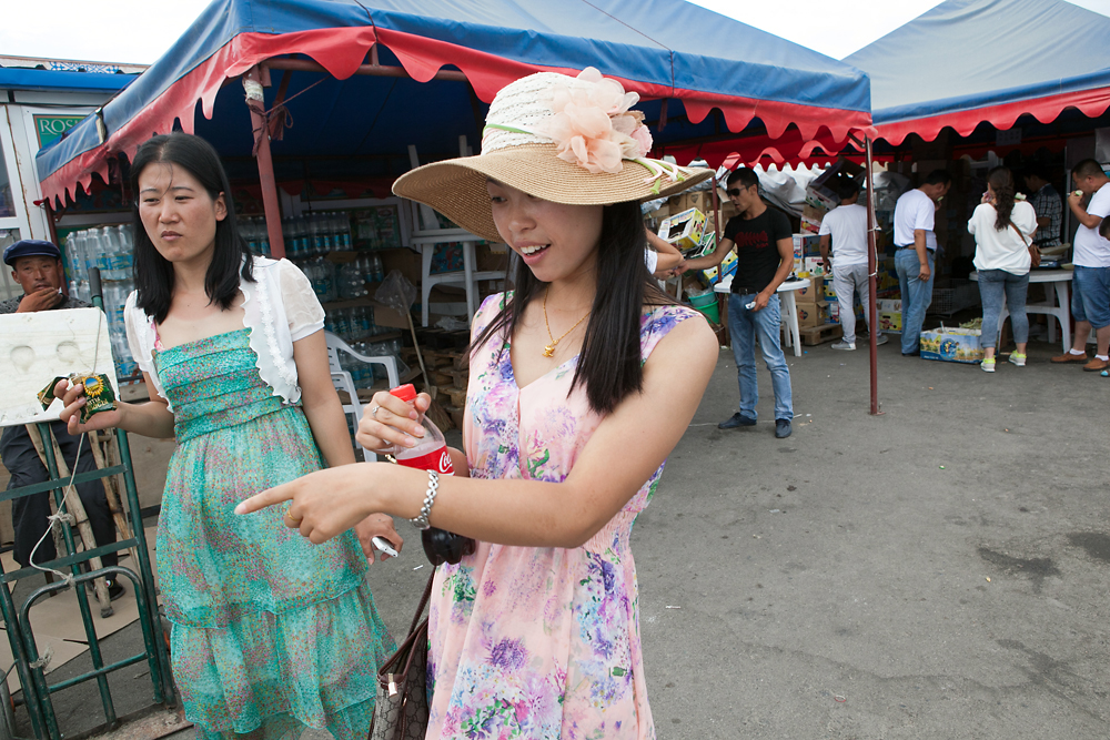 Chinese tourists shop for items from stalls on the Kazakhstani side.