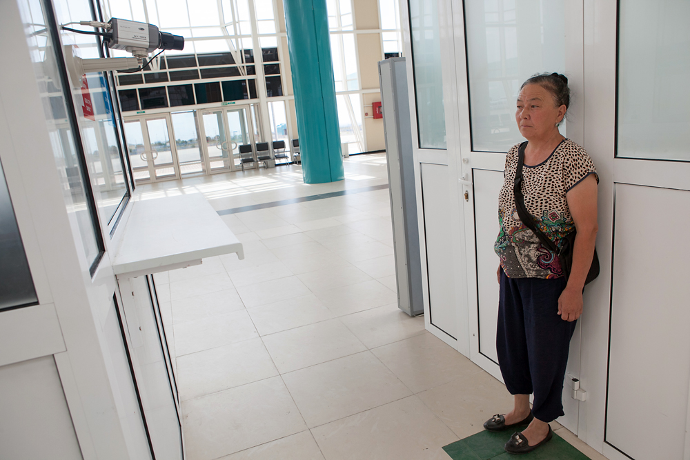A Kazakhstani woman passes through customs on her way into the ICBC.