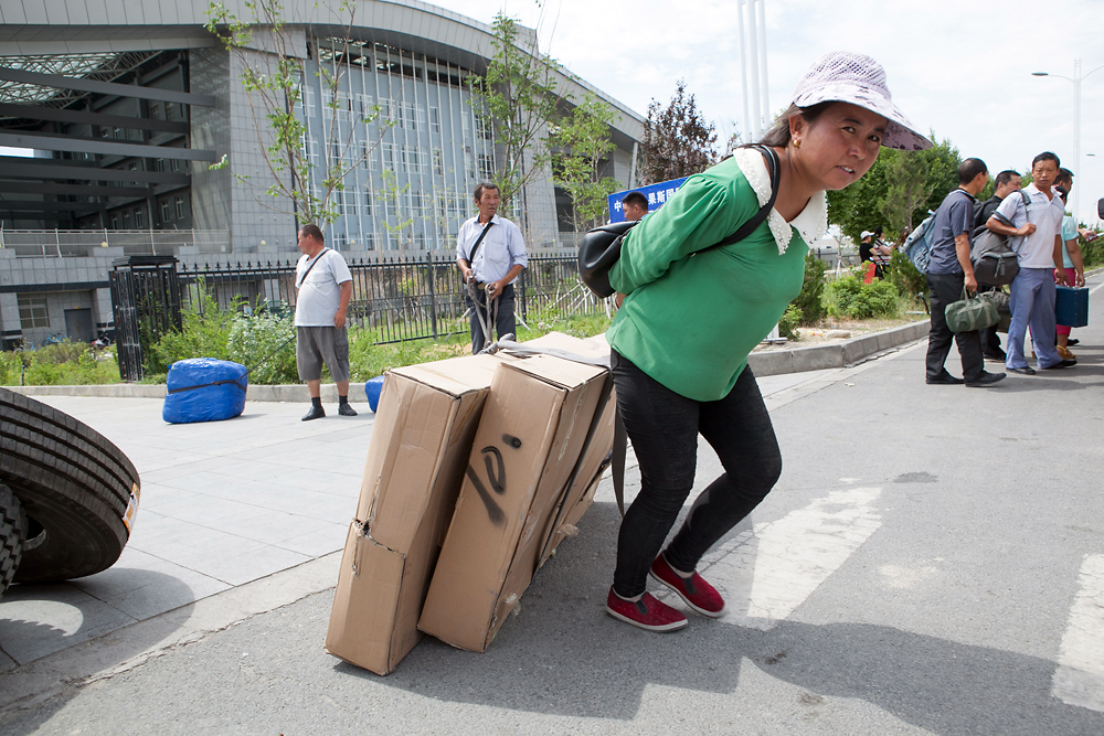 Chinese traders drag goods into the zone through the Chinese customs post.