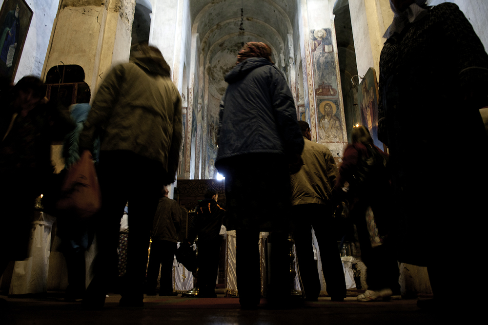 A Russian tour group visits the Church of the Virgin Mary.