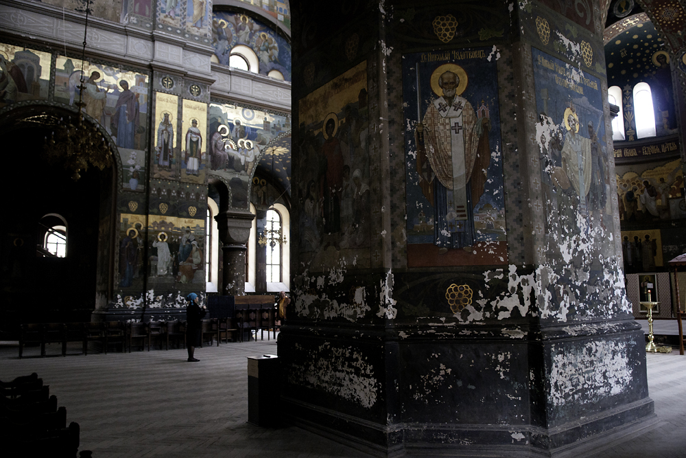 Paint chips away from most of the frescoes inside the cathedral of St. Pantaleon, within the center of Novy Afon.