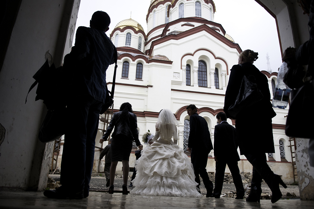 A bridal party enters the courtyard of the monastery, which overlooks the Black Sea.
