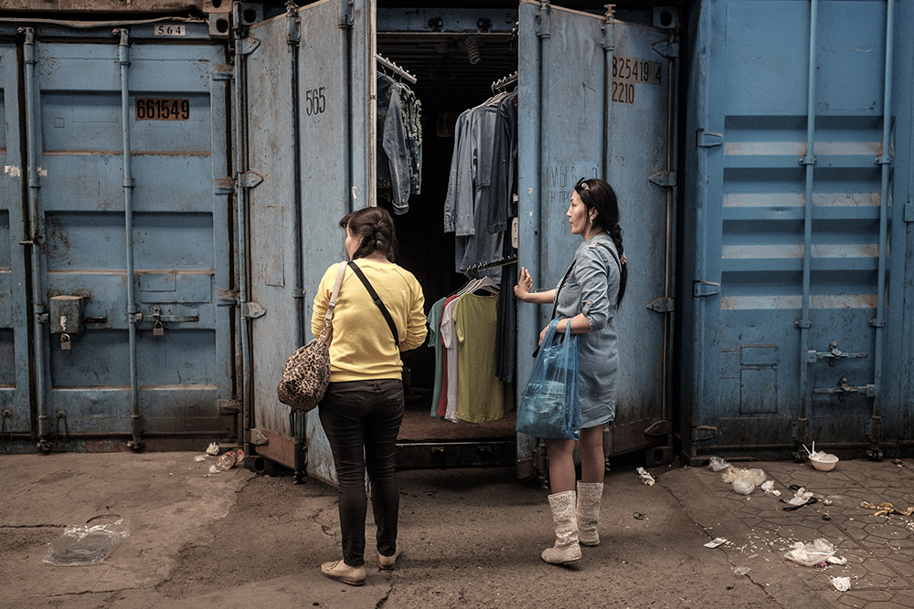 Traders close their container shop at 4:00 p.m. in one of the side alleys of the bazaar.