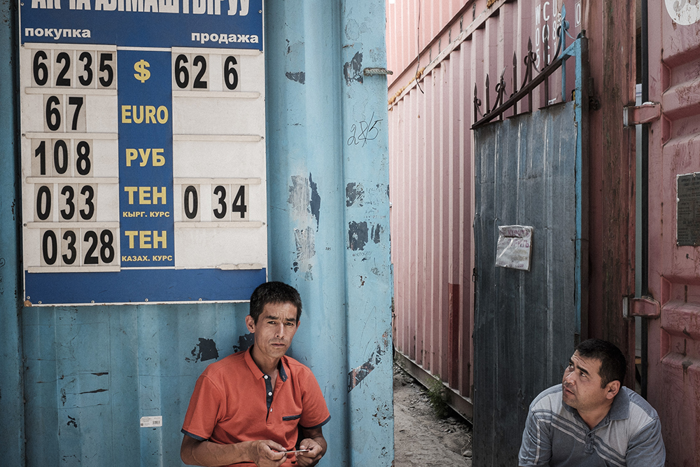 A money exchange office shows the value of the Kyrgyz som against US dollars, euros, rubles and other Central Asian currencies.