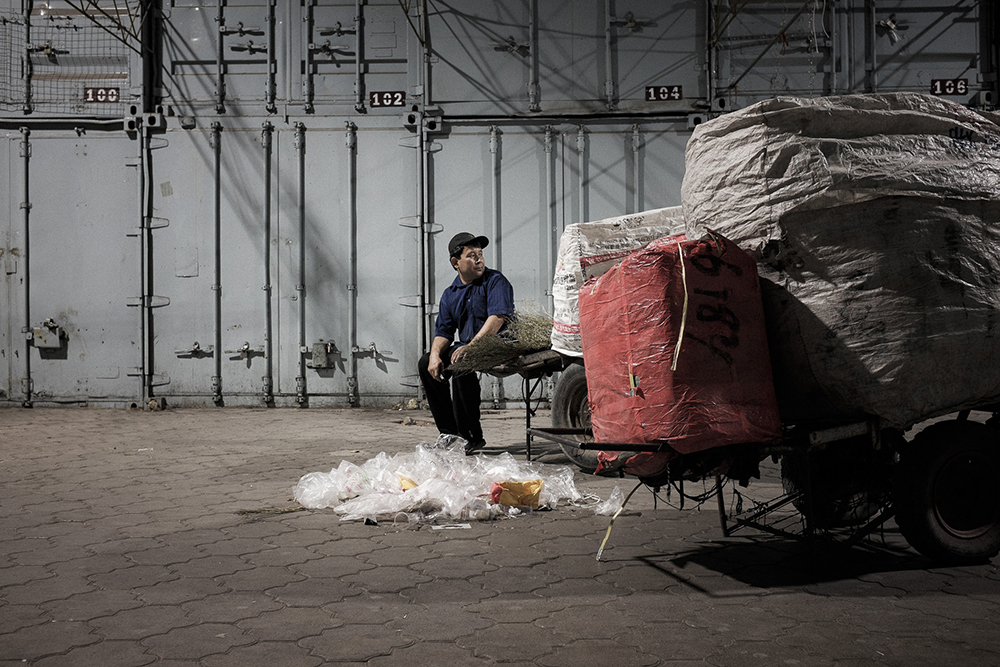 After sweeping the alleys, many cleaners carefully select paper, plastic and glass for sale to recycling companies.