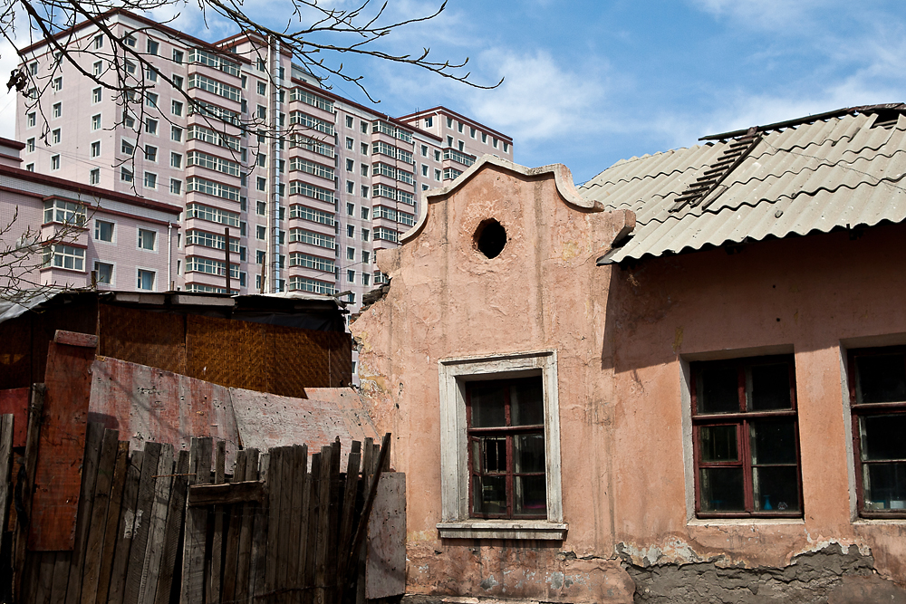 Crumbling Soviet-era Russian buildings have been torn down in many parts of the city to give way to high-rise apartments.