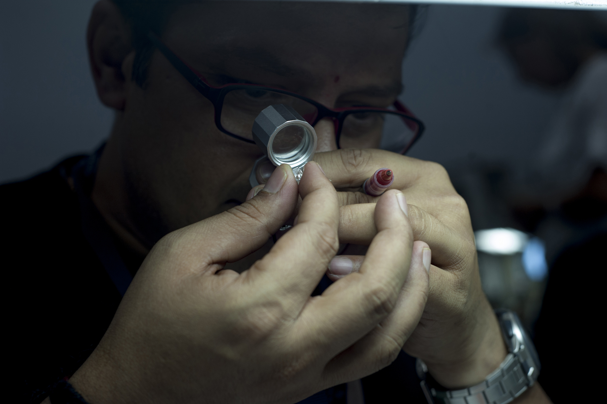 Pragnesh Shah examines a stone at Dimotech, Armenia's second largest diamond-refining factory. (Nazik Armanakyan)