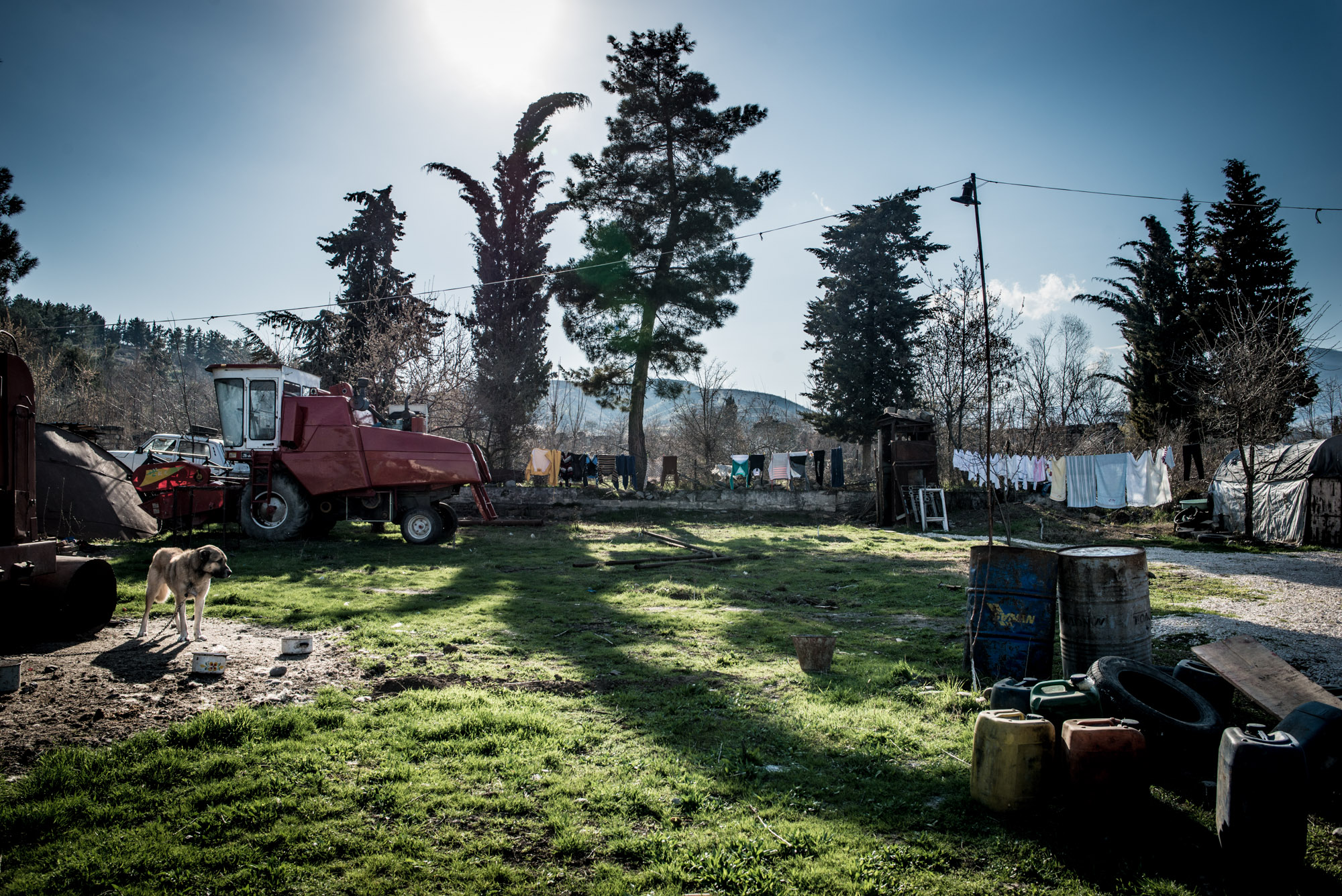 The backyard of a building that hosts Syrian Armenian families in Zangilan. The combine belongs to one of the families.