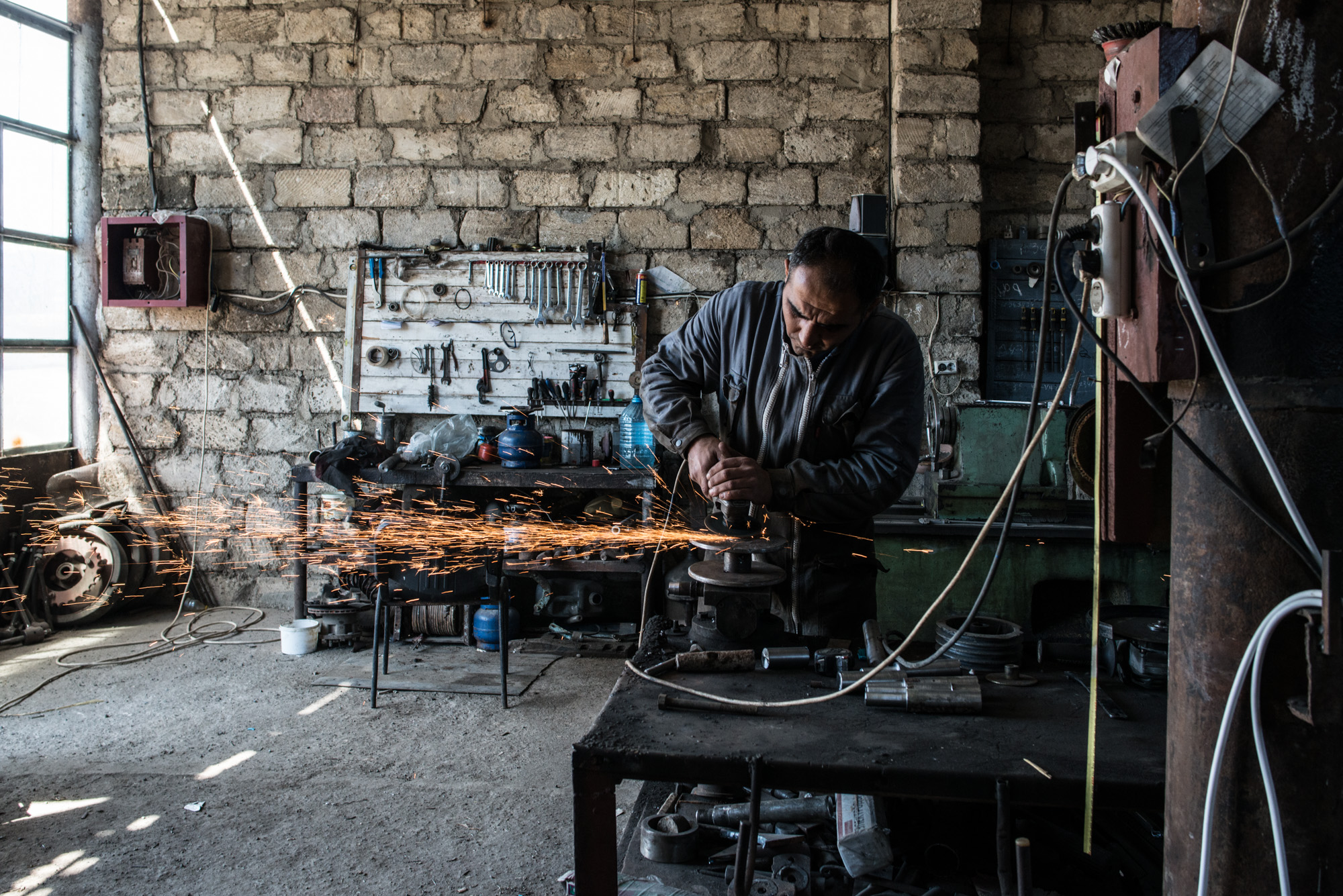 Nikol arrived from Syria in 2011. He is married to a local Armenian woman and runs a metal turning workshop in Zangilan.
