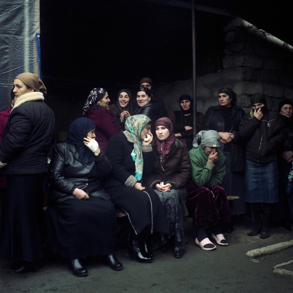 Women gather at the funeral of 82-year-old Alcaney Khangushvili - a spiritual leader of Kist women living in the Gorge.