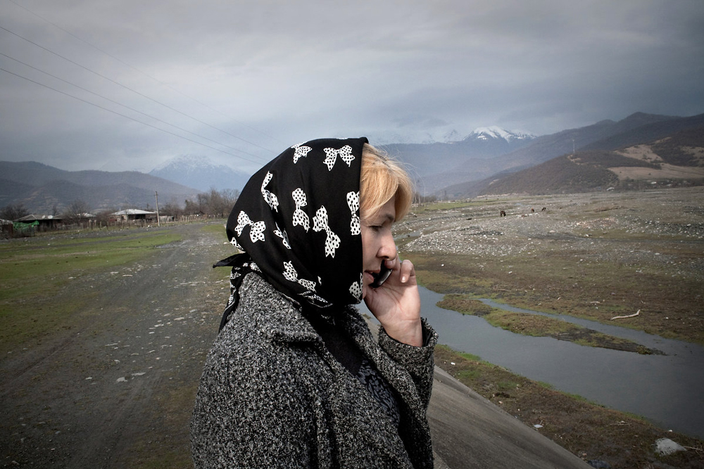 Lia Margoshvili, who runs an English-language school, talks on a phone near the Caucasus Mountains, beyond which lays Chechnya.