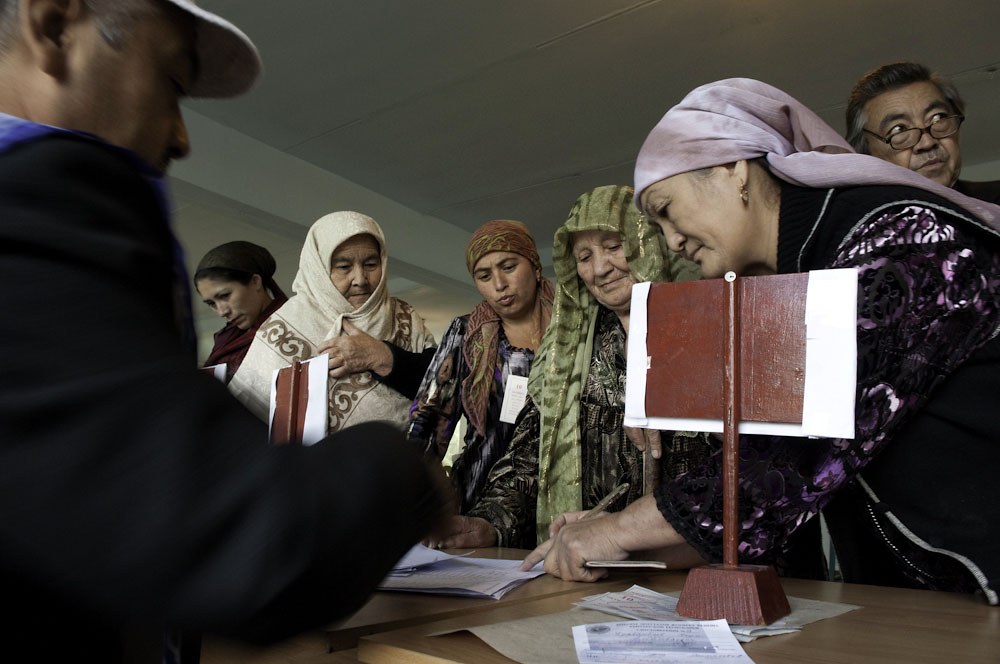 Women sign in to have their documents checked and receive a ballot.