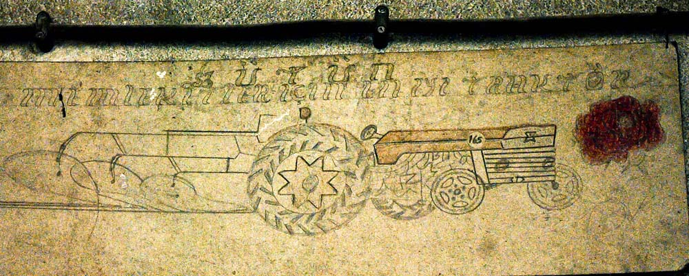 A drawing on a wall in Aktekin's workshop shows a more modern tractor.